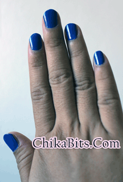 fingers with blue nail polish